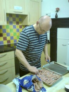 Simon cooking sausages.