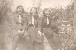 The girls in their Guide uniforms several years before in 1937, Monica, Audrey, Beryl