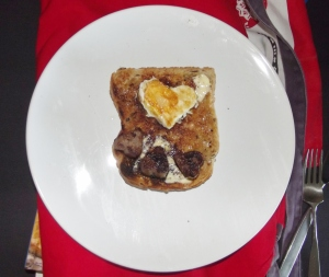 Egg and sausage hearts on toast. Unfortunately the egg fell on its face so doesn't look as pretty!